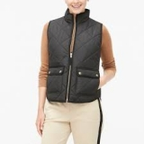 Puffer vest with snap pockets $55.99
